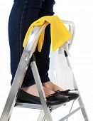 Woman standing on stepladder during housecleaning. All on white background.