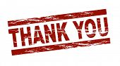 Stylized red stamp showing the term thank you. All on white background.