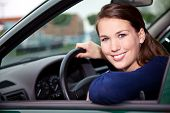 picture of commutator  - Attractive young woman in car - JPG