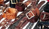 Market stall offering leather belts.