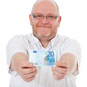 stock photo of average man  - Charismatic middle aged man holding 20 euro note - JPG