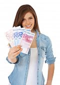 Attractive teenage girl holding 150 euro. All on white background.