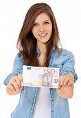 picture of scandinavian descent  - Attractive teenage girl holding 50 euro - JPG
