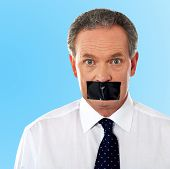Businessman With Tape On His Mouth