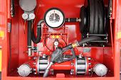 picture of bowser  - red dashboard of mobile gasoline bowser - JPG