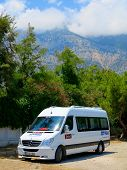 Minibus Parked On The Background Of Mountains,