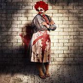 Murderous Monster Clown Standing In Full Length