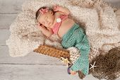 Newborn Baby Girl In A Mermaid Costume