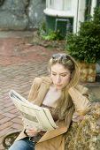 Blonde Woman Reading Newspaper