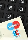 Ratingen, Germany - June 21, 2011: Closeup of Maestro electronic cash debit card on key pad. Maestro is a sub-brand of MasterCard International, one of the biggest credit card companies worldwide.