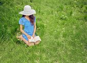 Woman Reads A Book On Nature