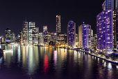 stock photo of cbd  - Brisbane cityscape by night on the Brisbane river - JPG