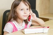 Young Child On Phone With Pursed Lips