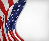 Closeup of rippled American flag on plain background