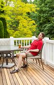Lazy Man Drinking Beer While Outdoors On Patio