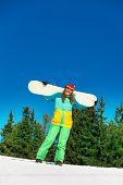 Happy Girl In Ski Mask Holding Snowboard