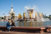 Two Girls Sitting Near Peoples Friendship Fountain