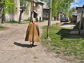 SUVOROV, RUSSIA - APRIL 27, 2008: Old granny is going out