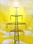 Electricity Pylon With Shine On Yellow Background.