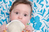 image of teats  - Six month old baby drinking milk from a bottle with the teat - JPG