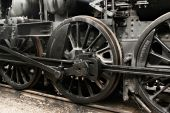 stock photo of train-wheel  - Black wheels of vintage steam engine on railway - JPG
