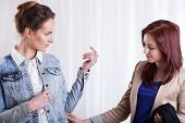Female Friend Trying On Denim Jacket