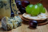 Roquefort blue cheese with grapes and crackers