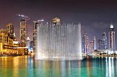 DUBAI, UAE - OCTOBER 30: A record-setting fountain system set on Burj Khalifa Lake - 6600 lights and 25 projectors, it shoots water 150 m into the air, on October 30, 2012 in Dubai, UAE