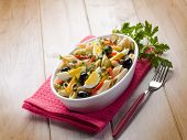 cold pasta salad with capsicum olives capers and boiled eggs