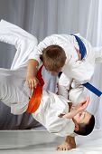 Training judo throw sportsman in judogi and with blue belt