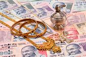 Gold Ornaments On Indian Currency