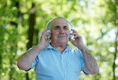 Smiling Elderly Man Enjoying His Music