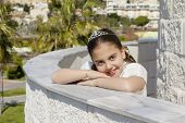picture of communion  - A young girl celebrating her First Holy Communion  - JPG