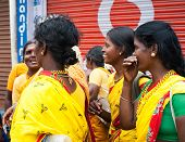 Indian Women In Colorful Sari At Crowded Street Of Indian City