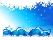 Six Christmas balls on blue and white background with blue ribbon lying on snowflakes