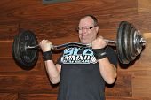 Contestant Rob Stoffer Lifting His National Record Cheating Curl