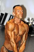 Male Bodybuilding Contestant Showing His Triceps