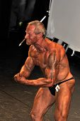 Male Bodybuilding Contestant Showing His Best Most Muscular Pose