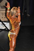 Female Bodybuilding Contestant Showing Her Back Pose