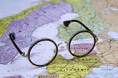 Glasses on a map of europe - Estonia
