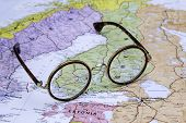 Glasses on a map of europe - Finland