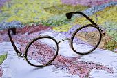 Glasses on a map of europe - Italy