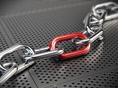 foto of chain link fence  - Chrome chain with a red link - JPG