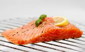 Marinated Salmon Fillet With Lemon On Grill, Soft Focus