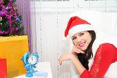 Beautiful and sexy woman wearing santa clause costum
