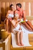 Senior woman and couple sweating in sauna
