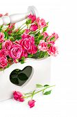 bouquet pink roses in wooden basket isolated on white background