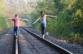 Two Children On Rails