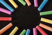 Colorful Chalks On Blank Blackboard