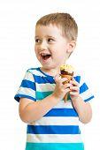 happy kid boy eating ice-cream in studio isolated